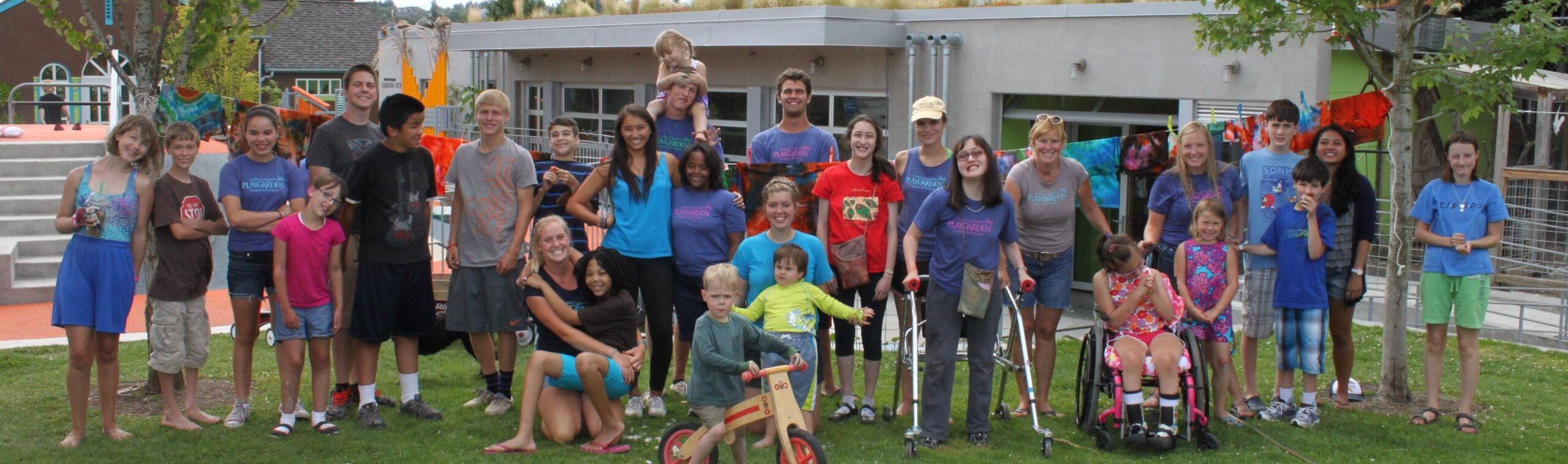 Group of campers and camp counselors at the Seattle Children's PlayGarden's inclusive summer camp