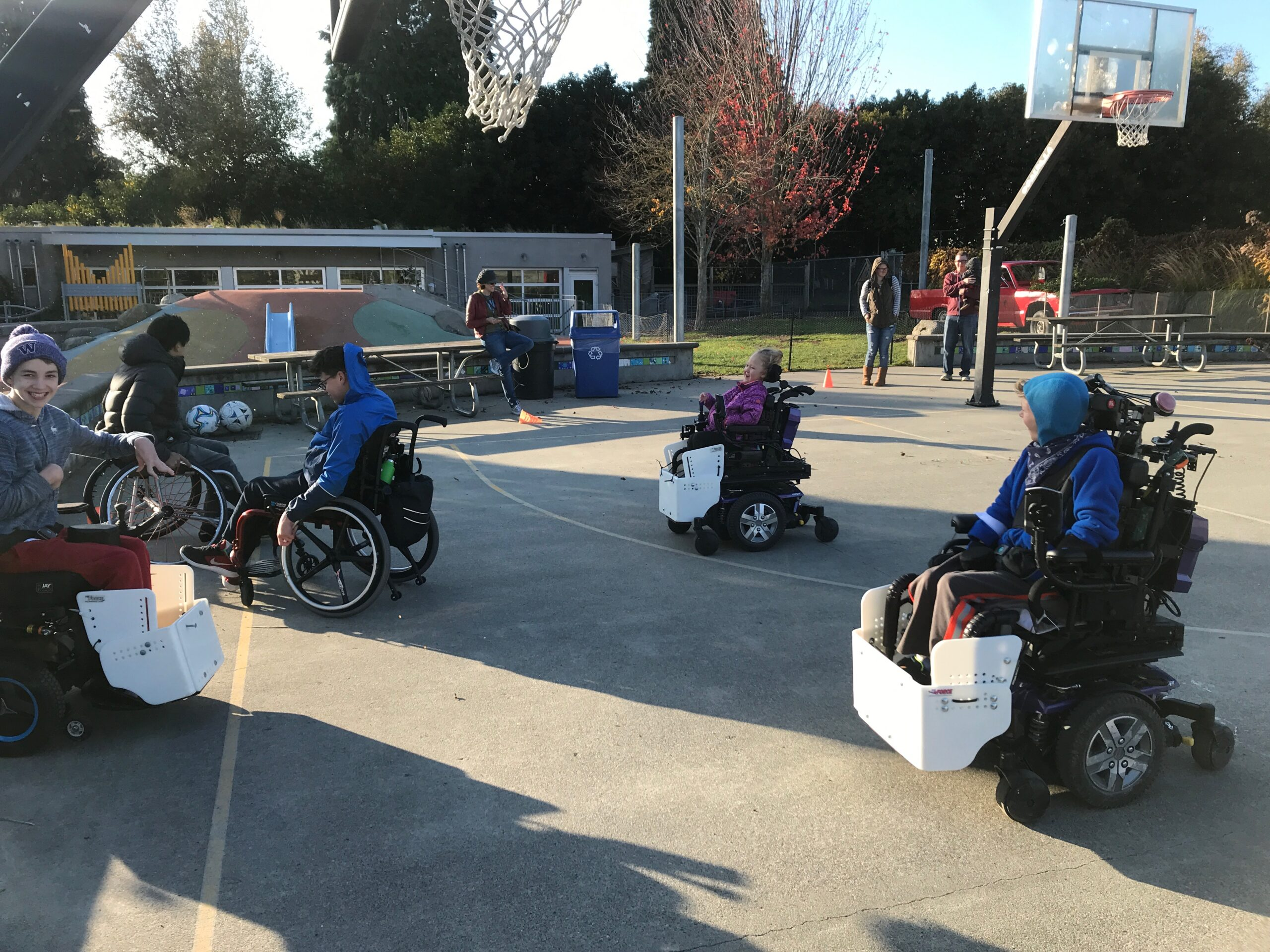 Teens playing power soccer in thier wheelchairs