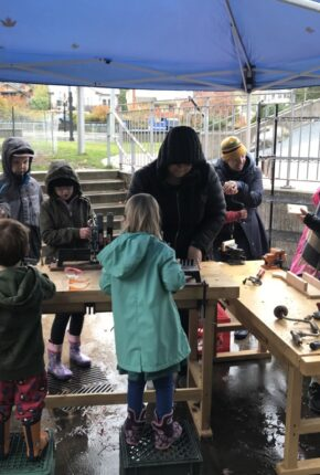 kids trying out different wood working tools