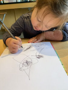 A child draws at preschool