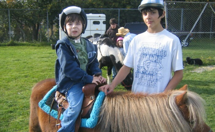 Gabe at 4 on a pony at the PlayGarden